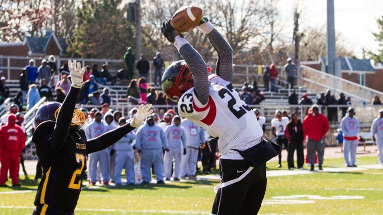 Imhotep Panthers wide receiver DJ Moore makes a great catch in last year's Legacy Bowl game vs. the MLK Cougars. The second-annual game will take place Thursday. (NewsWorks, file art/Brad Larrison)