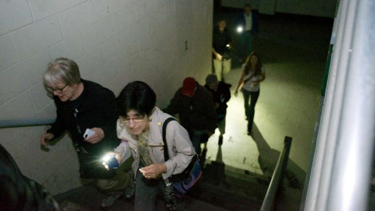 During a May open house at the shuttered Germantown High School building, visitors needed mobile-phone lights to navigate. (NewsWorks, file art)