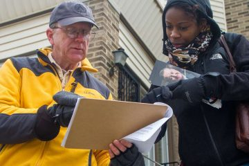 Brittany Graham and Joe Beech knock on doors in West Oak Lane canvassing for mayoral candidate Jim Kenney. (Brad Larrison/for NewsWorks)