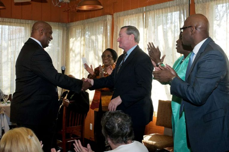 State Rep. Dwight Evans, left, shakes mayoral candidate Jim Kenney's hand at Monday morning's endorsement event in West Oak Lane. (Bastiaan Slabbers/for NewsWorks)
