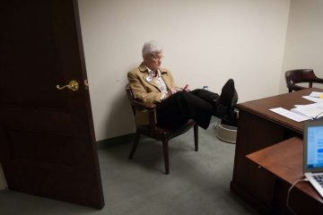 Lynne Abraham checks her phone during a break in a busy campaign Wednesday. (Tracie Van Auken/for NewsWorks)