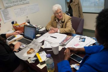 Lynne Abraham chats with staffers in her Center City campaign headquarters last week. (Tracie Van Auken/for NewsWorks)