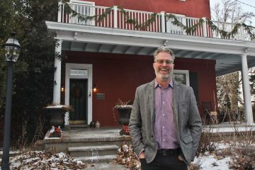 Will Hammerstein, the grandson of Oscar Hammerstein, stands outside  his grandfather's farmhouse in January. (NewsWorks file photo)