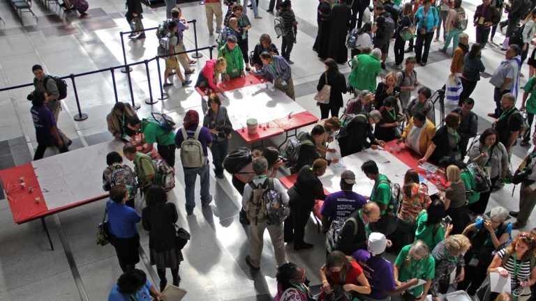 World Meeting opensAttendees at the World Meeting of Families attending the Philadelphia gathering work to set a Guinness World Record for most contributors to a paint-by-number. (Emma Lee/WHYY)