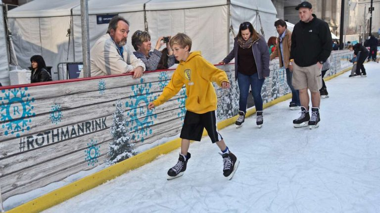 A few skaters at the Rothman Rink in Philadelphia's Dilworth Park wear shorts, illustrating the incongruity of springlike temperatures in December. (Kimberly Paynter/News Works)
