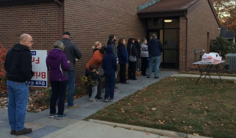 A line of voters in Langhorne, Bucks County, waits for their polling place to open. (Eugene Sonn/WHYY