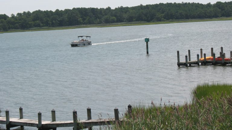 A boat passes Beach Cove in Delaware's Inland Bays near Bethany Beach. (John Mussoni/WHYY)