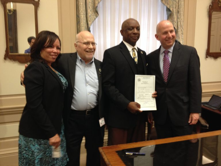 Representative Charles Potter Jr. (second from right) poses with Governor Jack Markell (far right) at the signing ceremony for House Bill 56. (Avi Wolfman-Arent, NewsWorks)