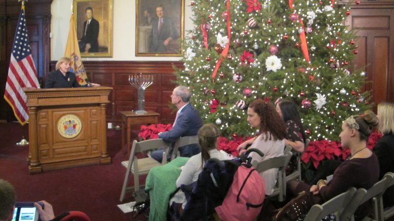 New Jersey Lt. Gov. Kim Guadagno meets with Catastrophic Illness in Children Relief Fund program participants at the Statehouse in Trenton. (Phil Gregory/WHYY)