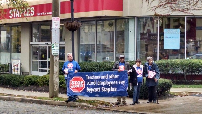 Members and supporters of the American Postal Workers Union marched outside the Germantown Avenue Staples on Thursday afternoon. (Dan Pasquarello/for NewsWorks)