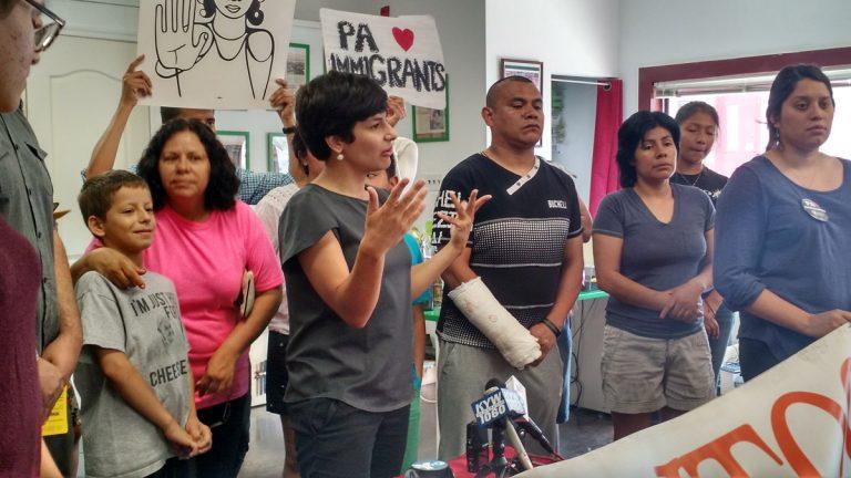 Immigrant advocates gather in South Philadelphia to decry a tie Supreme Court decision