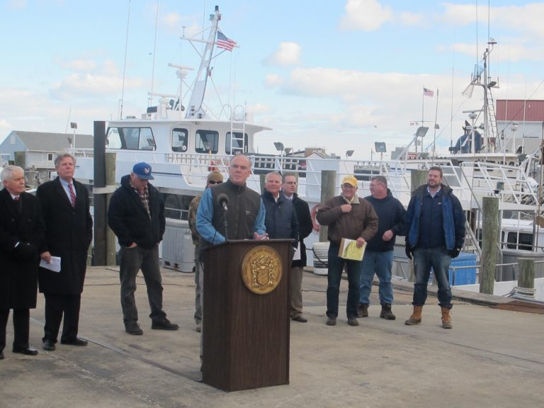 NJ DEP Commissioner Bob Martin telling anglers in Point Pleasant Beach he opposes proposed limits on flounder catches. (Phil Gregory/WHYY)