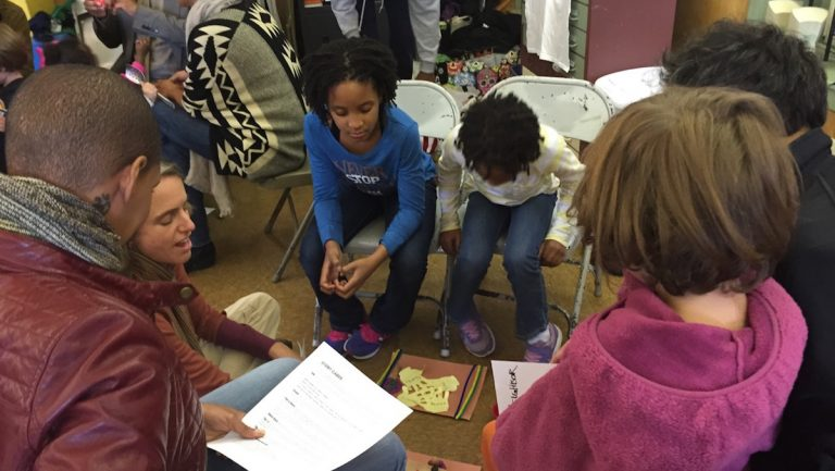 The Diggs and Solomon families share stories at a community gathering. (Courtesy of Jen Bradley)