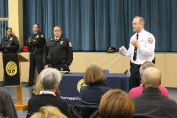Captain John Fleming of the 14th Police District addresses Chestnut Hill residents at a recent meeting held at the Norwood Fontbonne Academy. (Matt Grady/for NewsWorks)