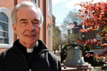 Father Paul Morrissey walks in the Healing Garden at St. Augustine's in Philadelphia. He is the author of 'The Black Wall of Silence.' (Emma Lee/WHYY)