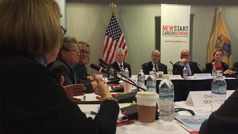 New Jersey resident Shelley Young described her struggle with unemployment to U.S. Secretary of Labor Thomas Perez (second from right) as well as other government officials and workforce professionals during a roundtable discussion at Rutgers University. (Joe Hernandez/WHYY)