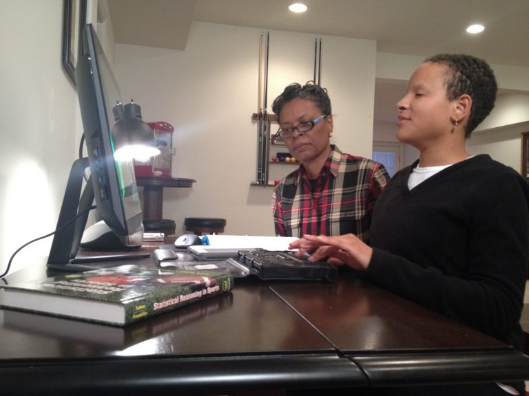 Elizabeth Harrington completes a homework assignment with help from her mother, Debbie. (Avi Wolfman-Arendt/WHYY)