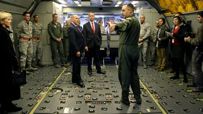 U.S. Rep. Tom MacArthur (center left) and U.S. Rep. Mac Thornberry (center), chairman of the Armed Services Committee,  tour a KC-10 aerial refueling plane at Joint Base McGuire-Dix-Lakehurst. (Emma Lee/WHYY)