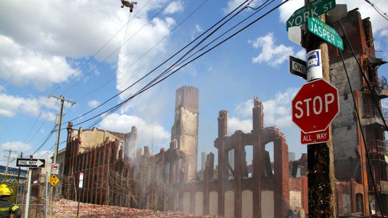 Philadelphia firefighters battle the blaze at York and Jasper streets in Kensington that killed two firefighters. (Emma Lee/for NewsWorks)