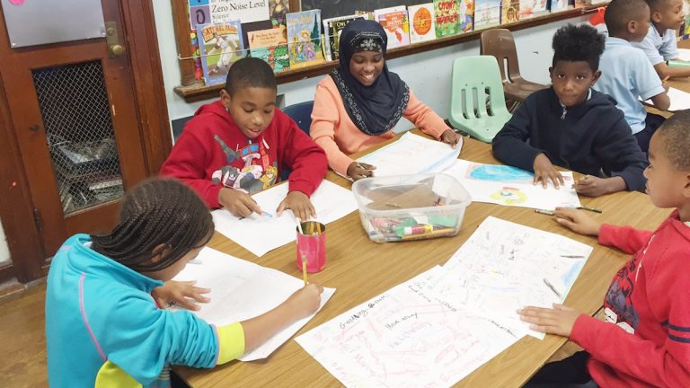 Students draw up their ideas for what they want to see on their playground. (Neema Roshania/WHYY)
