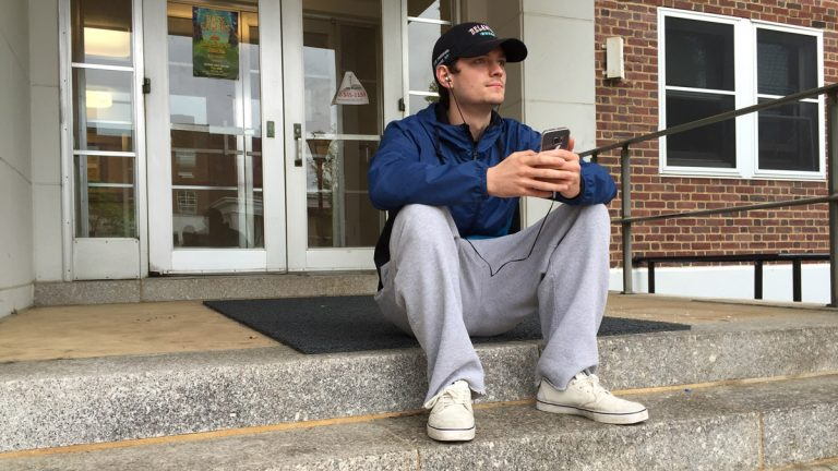 Sean Ryan sits on the stoop of his University of Delaware dorm