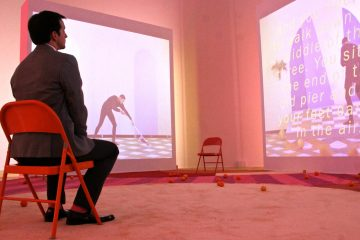 The video installation Easternsports by Alex Da Corte and Jayson Musson plays on four big screens at the Institute for Contemporary Art. (WHYY)