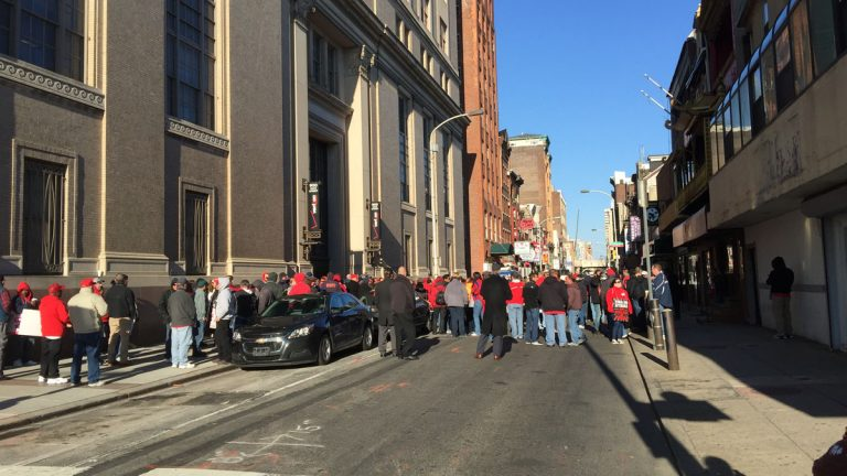 Verizon gather on Race Street between Ninth and 10th in Philadelphia after walking off the job to join a strike of nearly 40