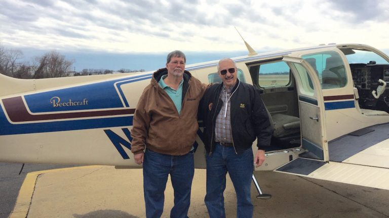 Michael Valdrighi (L) and William Moore ready to take off from Northeast Philadelphia Airport. (Neema Roshania Patel/WHYY)