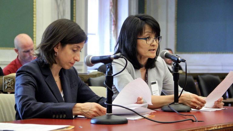 Pediatrician Dr. Esther K. Chung speaks at City Hall about the importance of breast feeding during a hearing on a bill that would require employers to provide a private place for breastfeeding mothers. (Emma Lee/WHYY)