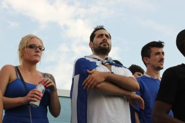 A fan wears the Greek flag around his neck during a FIFA match between Greece and Nigeria on Tuesday at PPL Park in Chester, Pa. (Emma Jacobs/WHYY)