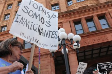 A small group of Tea Party protesters were met by a large rally of immigrant advocates outside the Mexican consulate on Friday in Philadelphia. (Emma Jacobs/WHYY)