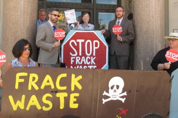 In this file photo, environmental groups campaign to convince legislators to ban fracking and not to accept wastewater from fracking operations in New Jersey. (Phil Gregory/WHYY)