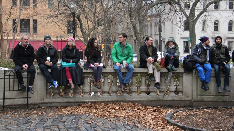 Rittenhouse Square wall-sitters celebrate the end of a brief ban with a lunch-time sit-in. (Emma Lee/WHYY)