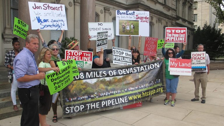 Representatives of groups opposed to the 115-mile PennEast natural gas pipeline gather at the New Jersey State House Tuesday to urge an end to the project. (Phil Gregory/WHYY)