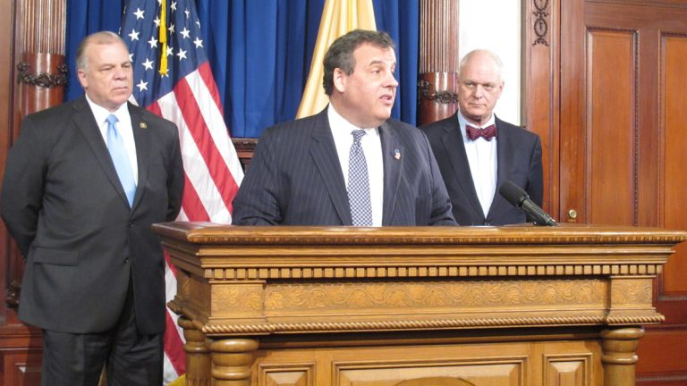 Flanked by New Jersey Senate President Steve Sweeney, left, and Atlantic City Mayor Don Guardian, Gov. Chris Christie  announces plans for the state to take control of Atlantic City finances. (Phil Gregory/WHYY)