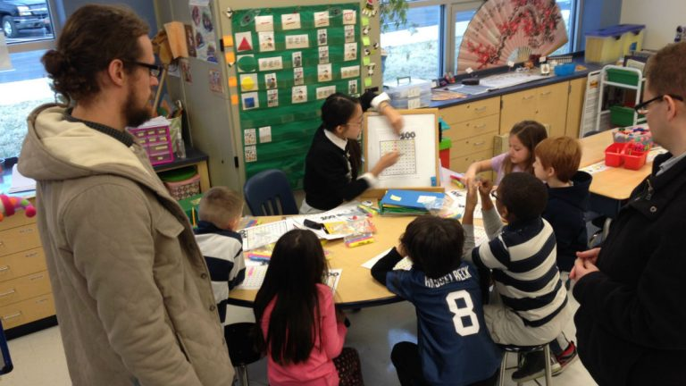 David Schultz (left) and Ben Tuck (right) observe a Chinese immersion class. (Avi Wolfman-Arent/NewsworksWHYY)