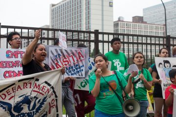 Immigrants rights groups gathered outside of the Philadelphia ICE Office to protest immigration policy. (Brad Larrison for WHYY)