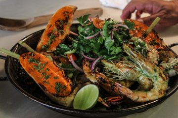 Black squid ink and seafood paella prepared by Chef Jose Garces (Kimberly Paynter/WHYY)