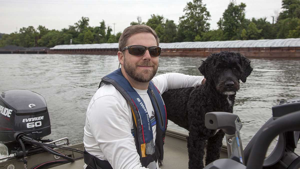 Rob Walters, a Pittsburgh riverkeeper and his dog, Rio. (Irina Zhorov/WESA)