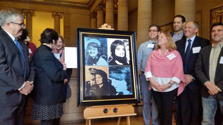 The Philadelphia Museum of Art unveils an Andy Warhol print that will be displayed outside the SawTown Tavern in Tacony as part of the museum's InsideOut program. (Peter Crimmins/WHYY)
