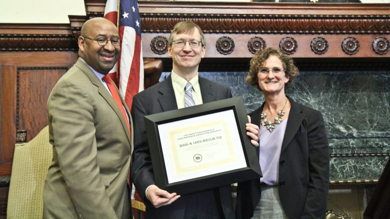 Mayor Michael Nutter (left) and Inspector General Amy Kurland (right) present Daniel Cantu-Hertzler  with the Inspector General's Joan Markman Award for Integrity. (Kimberly Paynter/WHYY)