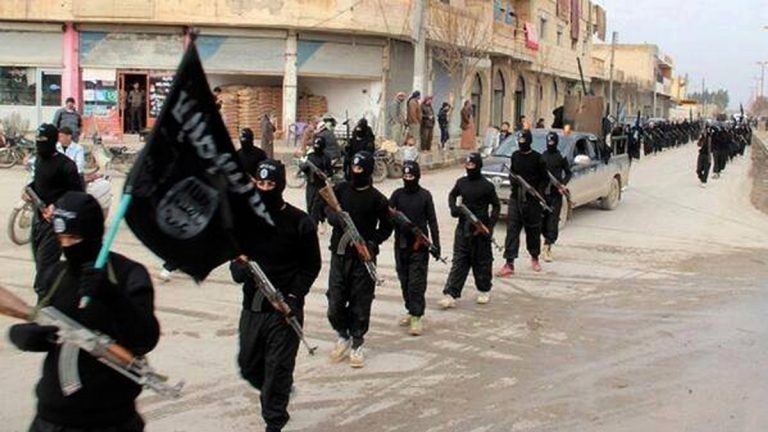 This undated file image posted on a militant website on Tuesday, Jan. 14, 2014, which has been verified and is consistent with other AP reporting, shows fighters from the al-Qaida linked Islamic State of Iraq and the Levant (ISIL) marching in Raqqa, Syria. (AP Photo/Militant Website, File)