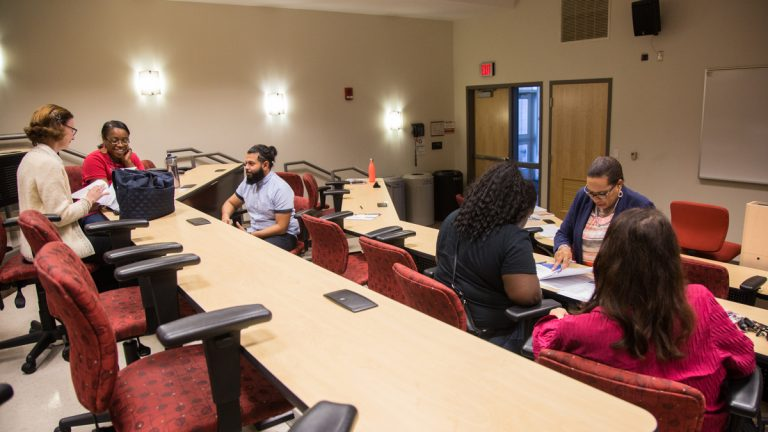 Former students of the now closed ITT Technical Insitute meet with teachers and advisers Thursday to learn more about their options for continuing their education at Montgomery County Community College. (Emily Cohen for NewsWorks)