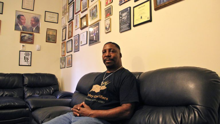 Former Blumberg resident James Norcome says he's comfortable in his new home in the Queens Row Apartments in Germantown. (Emma Lee/WHYY)