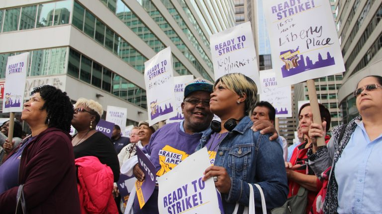 Commercial building cleaners rally near City Hall Tuesday. (Emma Lee/WHYY)