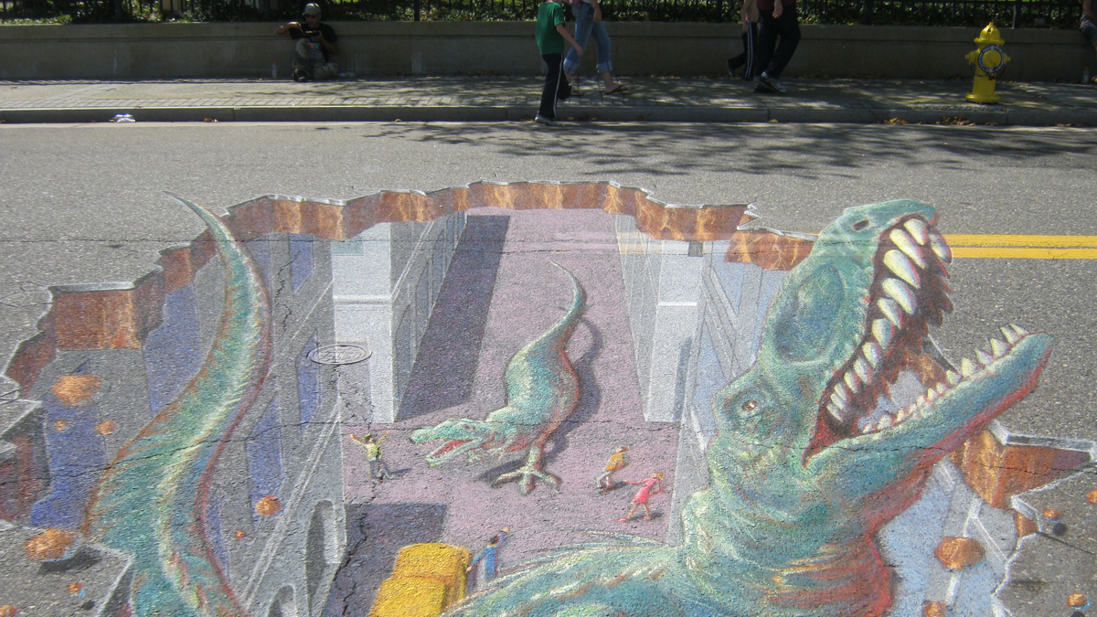 Chalk artists create 3D illusions on the the streets of
