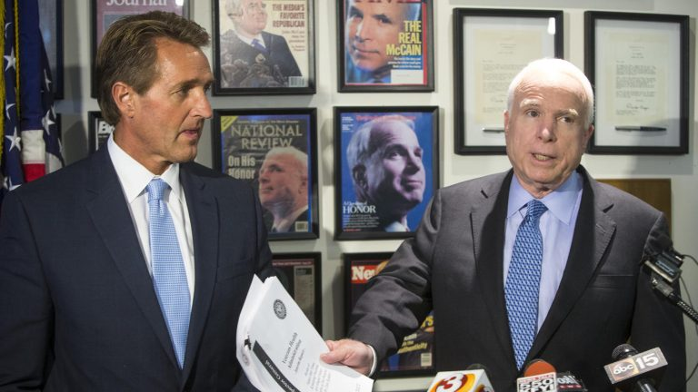 Arizona Sen. Jeff Flake, left, with the state's other senator, John McCain. (Charlie Leight / Associated Press)