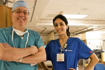 Dr. James Heitz, seen here with nurse Esmihan Almontaser, says crying after anesthesia occurs frequently enough that 'we should be aware of it as providers' even though it's not frequently documented in major anesthesiology textbooks (Karen Shakerdge/for WHYY)