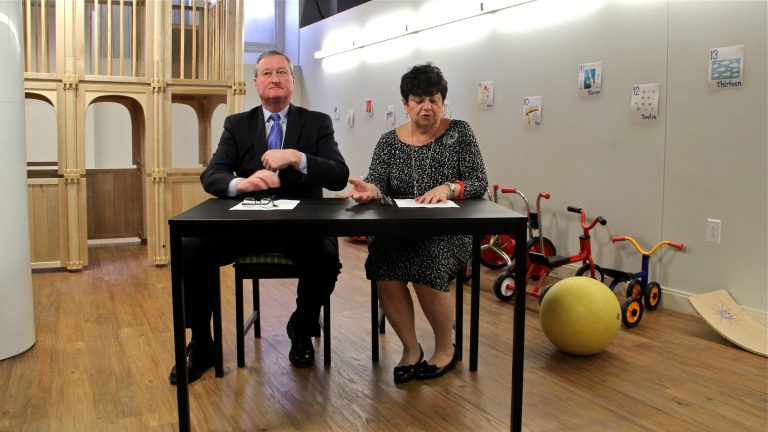 Mayoral candidate Jim Kenney presents his school-funding plan with the help of longtime Philadelphia teacher and librarian Rachelle Nocito at Philadelphia Cathedral Early Learning Center in West Philadelphia. (Emma Lee/WHYY)