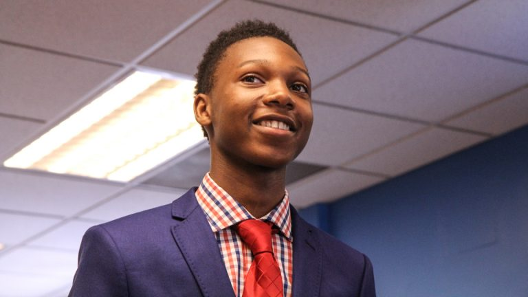 Nasir Mack, 16, has gotten a government-funded summer job for students. He was  recognized at a program announcing additional funding for the summer of 2015. (Kimberly Paynter/WHYY)